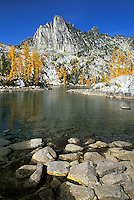 Prusik Peak and rocks in Leprechaun Lake, Enchantment Lakes, Alpine Lakes Wilderness, Washingto