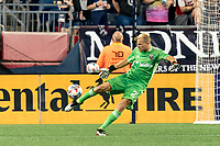 FOXBOROUGH, MA - AUGUST 18: Jon Kempin #21 of D.C. United clears the ball during a game between D.C. United and New England Revolution at Gillette Stadium on August 18, 2021 in Foxborough, Massachusetts.