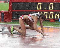 Leichtathletik, Deutsche Meisterschaft vom 25. bis 27.07.2014 im Donaustadion Ulm und auf dem Münsterplatz. Im Bild: Richtig nass ging es beim 400 Meter Start zu. Janin Lindenberg (SC Magdeburg).