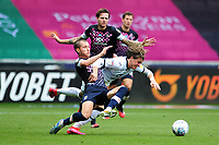 Dan Potts of Luton Town battles with Conor Gallagher of Swansea City during the Sky Bet Championship match between Swansea City and Luton Town at the Liberty Stadium in Swansea, Wales, UK. Saturday 27 June 2020.