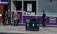 Customers outside National Westminster bank in Sidcup, Kent during the Coronavirus (COVID-19) outbreak where travel has been restricted across the country at Sidcup, England on 25 March 2020. Photo by Alan Stanford/PRiME Media Images