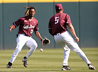 UALR center fielder Tyler Williams (13) and left fielder Miguel Soto misplay a fly ball Wednesday, April 7, 2021, during the second inning of the Razorbacks' 10-3 win over UALR at Baum-Walker Stadium in Fayetteville. Visit nwaonline.com/210408Daily/ for today's photo gallery. <br /> (NWA Democrat-Gazette/Andy Shupe)