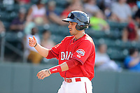 Shortstop Carlos Asuaje (20) of the Greenville Drive is congratulated after scoring a run in a game against the Augusta GreenJackets on Sunday, July 13, 2014, at Fluor Field at the West End in Greenville, South Carolina. Greenville won, 8-5. (Tom Priddy/Four Seam Images)