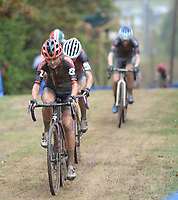 Marianne Vos of The Netherlands leads a group of riders up a hill Wednesday, Oct. 13, 2021, during the Union Cycliste Internationale Cyclo-cross World Cup at Centennial Park in Fayetteville. The city was one of 16 sites around the globe to hold a world cup event this year for Union Cycliste Internationale, known as International Cycling Union in the United States. Fayetteville will host the UCI World Championships at Centennial Park Jan. 28-30. Visit nwaonline.com/211014Daily/ for today's photo gallery.<br /> (NWA Democrat-Gazette/Andy Shupe)