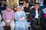 Mary Jane Garamendi and Presley ?Pep? Peek, both 91 years old and life-long residents of Mokelumne Hill, the grand marshals of the Mokelumne Hill Fourth of July Parade...They are seating along the parade route with noted historic highwayman Black Bart.