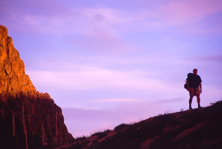 Hiker at Sunset in Mt. Margaret Backcountry, Mt. St. Helens National Volcanic Monument, Washington, US