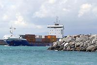 - container ship leaves the port of Genoa....- nave portacontainer esce dal porto di Genova