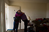Los Angeles, California<br /> January 28, 2014<br /> <br /> Former homeless veteran Michael Brody 72 yrs old in his apartment that he has because of a HUD Vash voucher. A VA nurse hugs with him during a recent visit.
