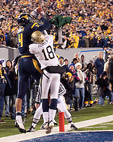 WVU wide receiver Wes Lyons (4) can't make this catch due to defensive efforts by Pitt defensive back Jarred Holley (18). The West Virginia Mountaineers defeated the Pittsburgh  Panthers 19-16 on November27, 2009 at Mountaineer Field at Milan Puskar Stadium, Morgantown, West Virginia.