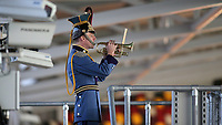 A bugler plays the Last Post ahead of kick-off during Brentford vs Middlesbrough, Sky Bet EFL Championship Football at the Brentford Community Stadium on 7th November 2020