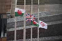 2021 04 21 The flags half-mast outside The Senedd Cymru/Welsh Parliamentin building, Cardiff, Wales