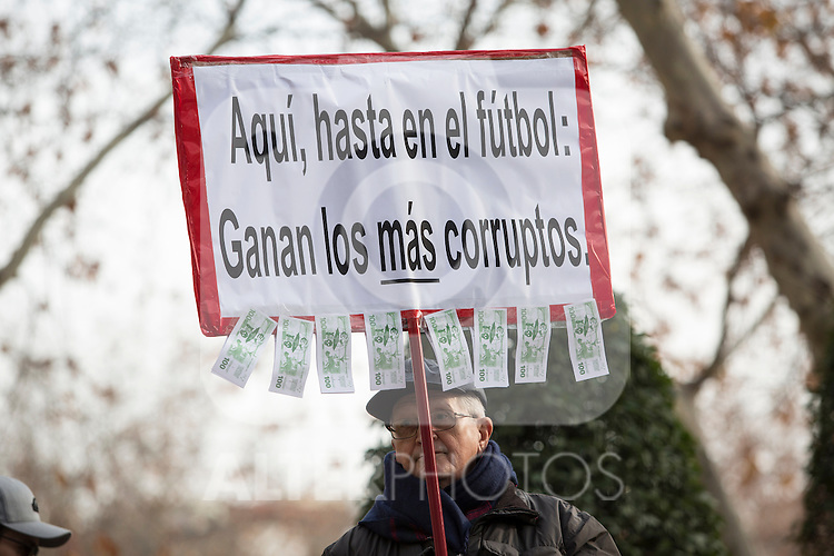 A man holds a banner that claims `Here, even in football: the most corrupted win´ outside of the national court while FC Barcelona's player Neymar Jr. testifies in an investigation into alleged irregularities regarding his transfer to Barcelona, in Madrid, Spain. February 02, 2016. (ALTERPHOTOS/Victor Blanco)