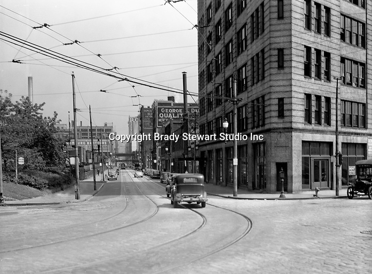 Pittsburgh PA:  View looking east up Penn Avenue from Water Street and the Point Bridge.  Point Building on the right.