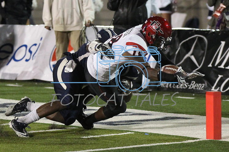 San Diego State's Dominique Sandifer (18) dives for the end zone against Nevada's Jeremiah Green (54) during the second half of an NCAA college football game against in Reno, Nev., on Saturday, Oct. 20, 2012. Sandifer scored on the play. (AP Photo/Cathleen Allison)
