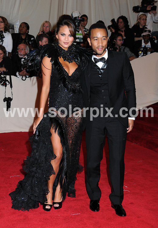 """**ALL ROUND PICTURES FROM SOLARPIX.COM**                                             **SYNDICATION RIGHTS FOR UK, AUSTRALIA, DENMARK, PORTUGAL, S. AFRICA, SPAIN & DUBAI (U.A.E) & ASIA (EXCLUDING JAPAN) ONLY**                                                                                  Caption:  """"Alexander McQueen: Savage Beauty"""" Costume Institute Gala at the Metropolitan Museum of Art  Arrivals The Metropolitan Museum of Art New York City, NY, USA                                                                             This pic:   Christine Teigen and John Legend                                                                                           JOB REF:13262        PHZ       DATE: 02.05.2011                                                           **MUST CREDIT SOLARPIX.COM OR DOUBLE FEE WILL BE CHARGED**                                                                      **MUST AGREE FEE BEFORE ONLINE USAGE**                               **CALL US ON: +34 952 811 768 or LOW RATE FROM UK 0844 617 7637**"""