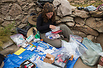 Andean Mountain Cat (Leopardus jacobita) veterinarian, Deana Clifford, checking medical supplies for collaring, Abra Granada, Andes, northwestern Argentina