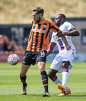 Tom Champion of Barnet holds off Hiram Boateng of Crystal Palace during the Friendly match between Barnet and Crystal Palace at The Hive, London, England on 11 July 2015. Photo by David Horn.