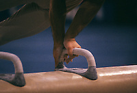 Close up of gymnast performing on pommel horse