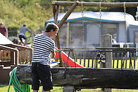 Young man backpacker washing himself in the camping in the morning