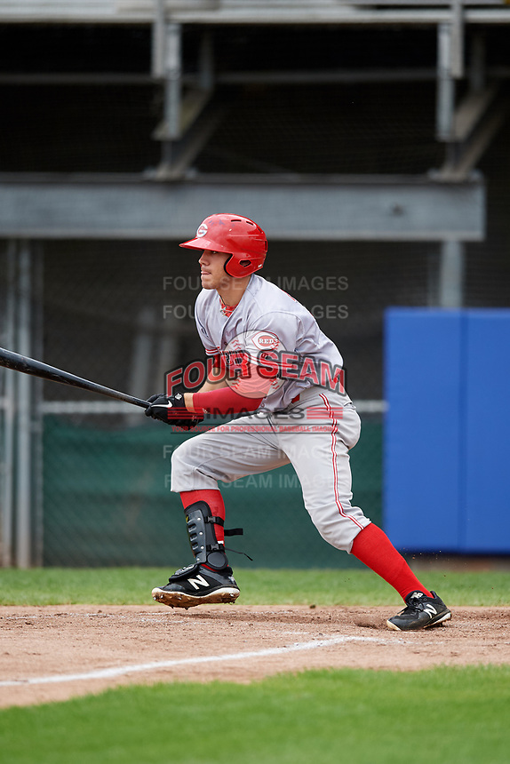 Greeneville Reds center fielder Mike Siani (34) follows through on a swing during the first game of a doubleheader against the Princeton Rays on July 25, 2018 at Hunnicutt Field in Princeton, West Virginia.  Princeton defeated Greeneville 6-4.  (Mike Janes/Four Seam Images)