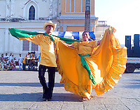 Couple Dancing in Traditional Costumes in the Central Park in Granada, Nicaragua.