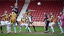 Pars' Andrew Geggan's header is cleared off the line.