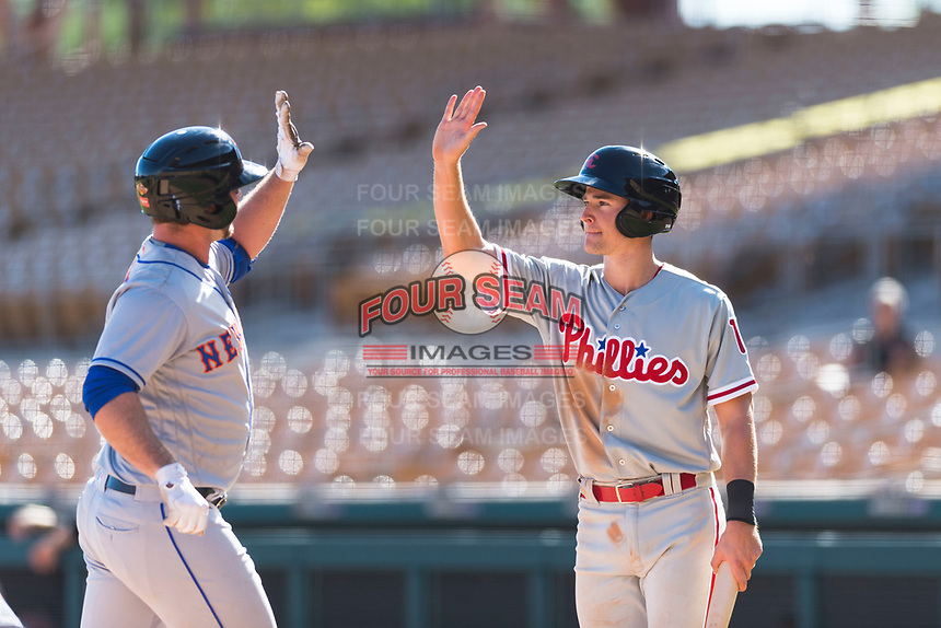 Scottsdale Scorpions right fielder Luke Williams (15), of the Philadelphia Phillies organization, congratulates Peter Alonso (20), of the New York Mets organization, after he hit a home run during an Arizona Fall League game against the Glendale Desert Dogs at Camelback Ranch on October 16, 2018 in Glendale, Arizona. Scottsdale defeated Glendale 6-1. (Zachary Lucy/Four Seam Images)