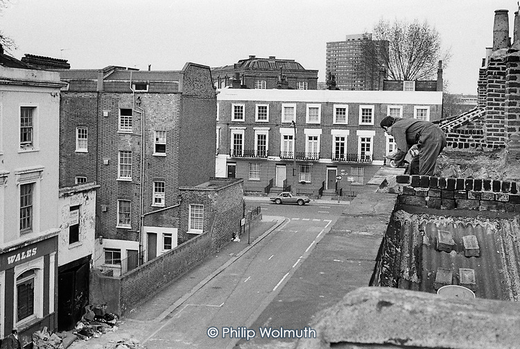 Carol Street co-op roofing team at work on a row of squatted houses in Camden Town, London, which was later granted short-life status and subsequently became a council-supported housing co-operative.