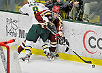 10 February 2012: Boston College Eagles forward Quinn Smith, a Freshman from Fairfield, CT, is checked by forward Sebastian Stalberg, a Junior from Gothenburg, Sweden, during a game against the University of Vermont Catamounts at Gutterson Fieldhouse in Burlington, Vermont. The Eagles defeated the Catamounts 6-1 in their Hockey East matchup. Mandatory Credit: Ed Wolfstein Photo