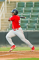 William Carmona (23) of the Lakewood BlueClaws follows through on his swing against the Kannapolis Intimidators at CMC-Northeast Stadium on August 13, 2013 in Kannapolis, North Carolina.  The Intimidators defeated the BlueClaws 12-8.  (Brian Westerholt/Four Seam Images)