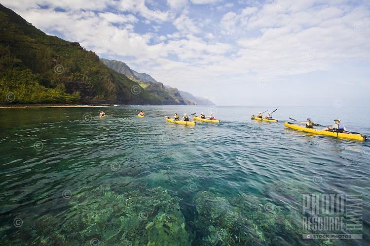 People paddling kayaks off the Na Pali coast of Kauai