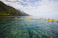 People paddling kayaks off the Na Pali coast of Kauai