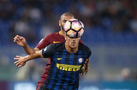 Calcio, Serie A: Roma vs Inter. Roma, stadio Olimpico, 2 ottobre 2016.<br /> Roma's Bruno Peres, left, and FC Inter's Stevan Jovetic fight for the ball during the Italian Serie A football match between Roma and FC Inter at Rome's Olympic stadium, 2 October 2016.<br /> UPDATE IMAGES PRESS/Isabella Bonotto