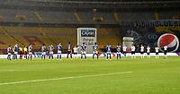 BOGOTA - COLOMBIA, 27-11-2020: Jugadores de Millonarios F. C. Once Caldas y Arbitros, guardan un minuto de silencio por el reciente fallecimiento de Diego Armando Maradona previo al partido entre Millonarios F. C. y Once Caldas por la fecha 1 de la Liguilla BetPlay DIMAYOR 2020 jugado en el estadio Nemesio Camacho El Campin de Bogota.  Players of Millonarios F. C. Once Caldas and Referees, observe a minute of silence for the recent death of Diego Armando Maradona, prior a match between Millonarios F. C. and Once Caldas  for the 1st date of BetPlay DIMAYOR 2020 Liguilla played at Nemesio Camacho El Campin of Bogota. Photo: VizzorImage / Luis Ramirez / Staff.