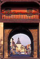 France, Alsace, Rosheim, Bas-Rhin, Europe, wine region, Gateway arch decorated with flowers at the entrance to the picturesque village of Rosheim in the wine region of Alsace.