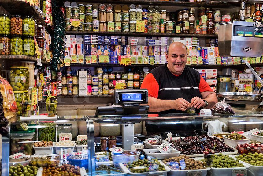 Vendor at the La Boqueria market located by the La Rambla, Barcelona, Spain