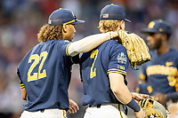 Michigan Wolverines outfielder Jordan Brewer (22) talks with shortstop Jack Blomgren (2) during Game 6 of the NCAA College World Series against the Florida State Seminoles on June 17, 2019 at TD Ameritrade Park in Omaha, Nebraska. Michigan defeated Florida State 2-0. (Andrew Woolley/Four Seam Images)