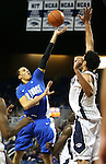 Nevada's AJ West blocks a shot by Air Force's Hayden Graham during an NCAA basketball game in Reno, Nev., on Saturday, Feb. 1, 2014. Nevada won 69-56 in overtime. (AP Photo/Cathleen Allison)