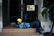 A labourer takes a nap outside a restaurant opposite the Adriatico Cafe in Manila, Philippines. Photo: Sanjit Das