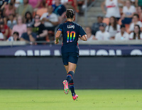 HOUSTON, TX - JUNE 13: Carli Lloyd #10 of the USWNT sprints during a game between Jamaica and USWNT at BBVA Stadium on June 13, 2021 in Houston, Texas.