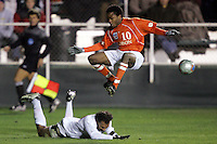 Clemson's Dane Richards leaps over a fallen New Mexico defender. The University of New Mexico defeated Clemson University 2-1 in the NCAA Semifinal at SAS Stadium in Cary, North Carolina, Friday, December 9, 2005.