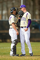 Western Carolina Catamounts catcher Danny Bermudez (21) has a chat on the mound with starting pitcher Morgan McKinney (7) during the game against the Davidson Wildcats at Wilson Field on March 10, 2013 in Davidson, North Carolina.  The Catamounts defeated the Wildcats 5-2.  (Brian Westerholt/Four Seam Images)