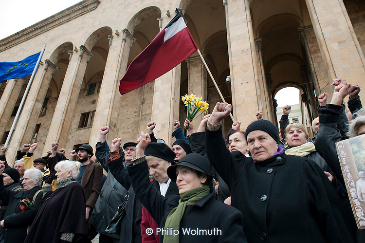 Relatives and friends of the victims of the 1989 Soviet massacre of 20 hunger strikers at a memorial rally outside the Parliament building in Tbilisi, Georgia.