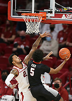 Arkansas forward Vance Jackson Jr. (2) blocks Georgia Justin Kier (5), Saturday, January 9, 2021 during the first half of a basketball game at Bud Walton Arena in Fayetteville. Check out nwaonline.com/210110Daily/ for today's photo gallery. <br /> (NWA Democrat-Gazette/Charlie Kaijo)