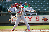 Memphis Redbirds first baseman Xavier Scruggs (16) swings the bat during the first game of a Pacific Coast League doubleheader against the Round Rock Express on August 3, 2014 at the Dell Diamond in Round Rock, Texas. The Redbirds defeated the Express 4-0. (Andrew Woolley/Four Seam Images)