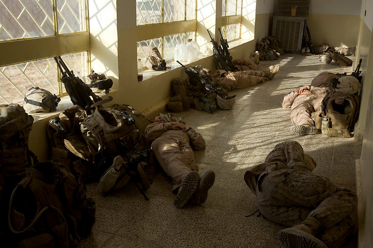 Marines with 2d Battalion, 2d Brigade, 7th Iraqi Division Military Transition Team rest in a medical clinic in Zawiyah, Iraq, Saturday, November 3, 2007. The Marines are using the clinic as an Expeditionary Patrol Base as they conduct a joint operation with Iraqi soldiers from 2-2-7 to clear the city and surrounding area. 2-2-7 MiTT is deployed with Multi National Forces-West in support of Operation Iraqi Freedom in the Al Anbar province of Iraq to develop Iraqi Security Forces, facilitate the development of official rule of law through democratic reforms, and continue the development of a market based economy centered on Iraqi reconstruction. (Official USMC photograph by Cpl. Shane S. Keller)