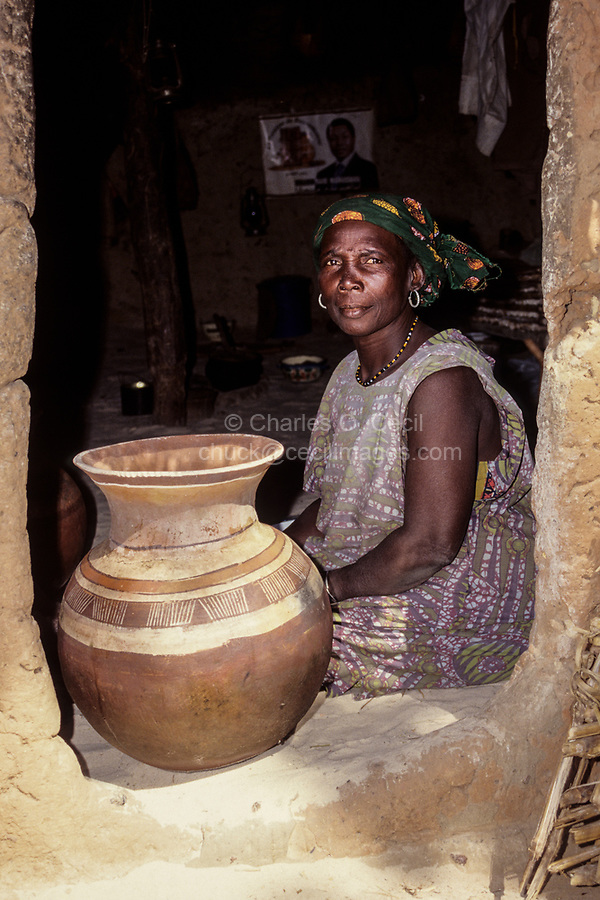 Village Chief's Wife with Pot Sitting in Entrance to her House, Drouel, Niger.