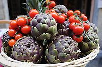 Artichokes and tomatoes at market