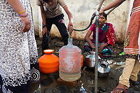 Local people in Latur collect water from water pumps in the city. The trucks visit many of the city's communities delivering water to those in need. Crowds regularly develop and arguments often ensue as the city's desperate residents make sure they receive enough water.