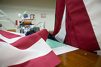 21 June 2005 - Oaks, PA - Connie Roby (hidden) assembles parts of an American flag at the Annin & Co. flag manufacturing plant in Oaks, PA.
